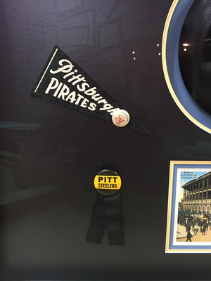 Pirates pennant and Steelers Button